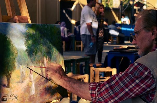 "Artist ""imagining the beautiful world"" © Mo'tasem Awad"